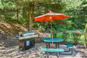 Enjoy a meal with friends in the community picnic area with grill  Residences at Westborough