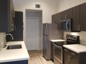 Silver package homes with espresso cabinetry and quartz countertops |Walnut Creek