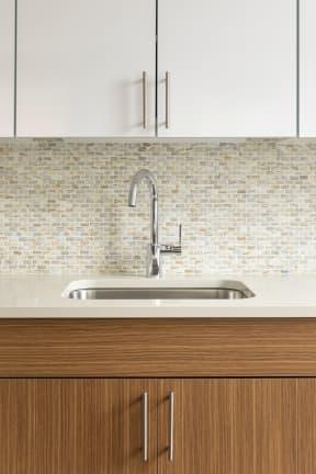 kitchen sink with tile backsplash | The Merc apartments