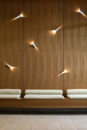 lounge area seating with lights on wall | The Merc building