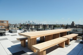 Large Tables On Rooftop Deck  At Revel Apartments In Minneapolis, MN