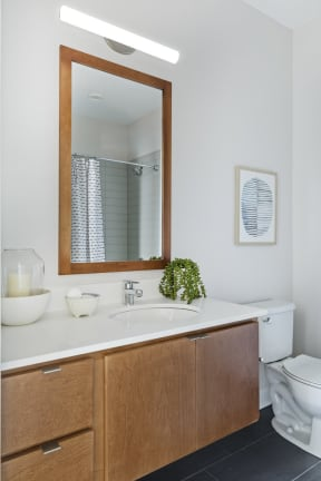 Modern Penthouse Bathroom With Great Lighting At Revel Apartments In Minneapolis, MN