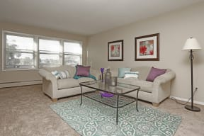 Bright and airy living room with plenty of space for catching the game or weekend relaxation.