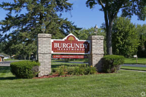 Monument sign for the burgundy apartments.