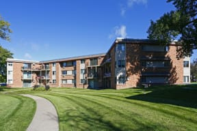 Paved walkways lead to the buildings with plenty of balconies and patios for residents to enjoy.