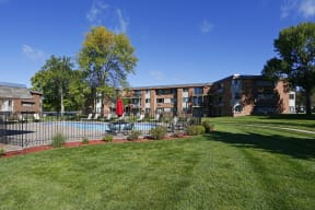 Relax poolside with beautiful outdoor views of our community.
