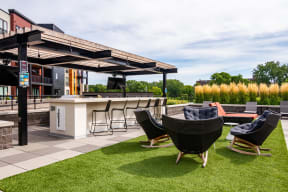 Outdoor entertaining space with a pergola, dining area, and comfortable seating.
