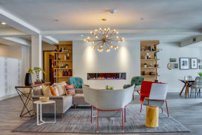 Secondary view of the fireplace lounge area of the community space complete with two large built in bookshelves.