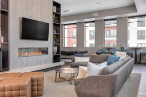 Naturally lit and spacious community space with a fireplace.