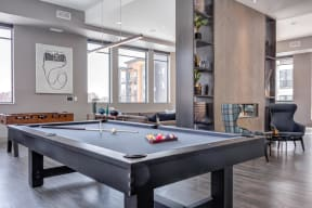 The gallery community space offers both a pool and foosball table all naturally lit with countless windows.