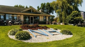 Beautifully landscaped exterior of a golf course main building in New Hope, MN.