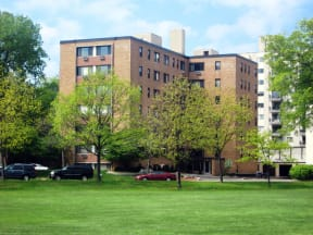Exterior view of the Portage apartments across grassy field