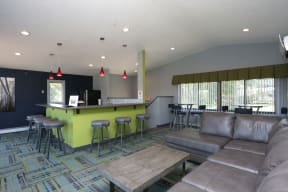 Community room with large windows and a kitchen for hosting gatherings.