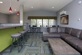Community room with plenty of seating for entertaining, relaxing, or co-working.