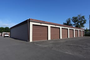 Detached garages with large driveways.