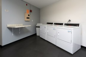 On site laundry facilities with counter space.