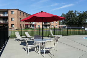 Patio seating on the sundeck right by the pool.