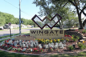 Welcome to Wingate Apartments with monument sign.