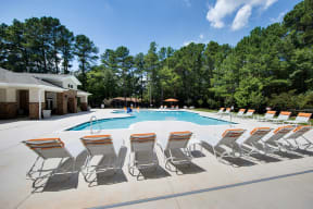 Swimming Pool with Lounge Chairs at Shellbrook Apartments in Raleigh NC