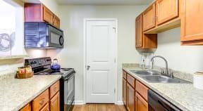 Unit Kitchen with Black Appliances