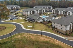 Aerial view of One White Oak apartment grounds and city view in Cumming, GA
