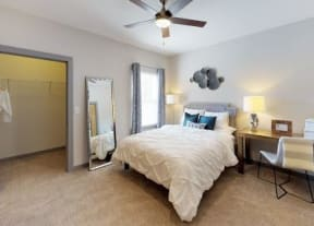 Furnished One White Oak bedroom with carpet flooring and medium window in Cumming, GA apartments