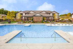 Gorgeous, resort-style swimming pool on a sunny day in One White Oak rentals in Cumming, GA