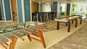Clubhouse with hockey and foosball tables for Coda Orlando residents to use in Orlando, FL