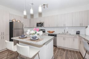 Modern Fully Equipped Kitchen at One White Oak Apartments