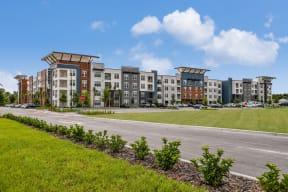 Street leading up to Coda Orlando apartment homes in Orlando, FL
