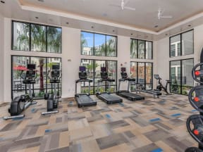 Coda Orlando treadmills facing luxurious swimming pool in Orlando, FL apartments' fitness center