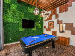 Coda Orlando pool table room with huge TV as clubhouse entertainment for Orlando, FL apartment rental residents