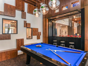Pool table room separated from Coda Orlando clubhouse spaces in Orlando, FL apartment rentals