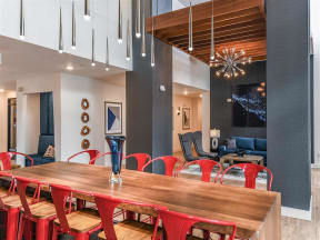 Clubhouse seating area for groups of any size with TV in Coda Orlando apartment rentals in Orlando, FL