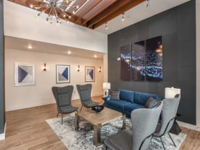 Comfortable sofas and chairs in Coda Orlando clubhouse for resident use in Orlando, FL apartments for rent