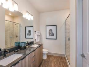 Nice white bathtub and singular sink in bathroom in Coda Orlando Orlando, FL apartments