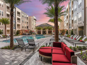 View of resort-style swimming pool, enormous clubhouse and efficient BBQ grill section in Coda Orlando apartments for rent