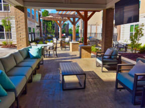 Outdoor Pointe at Lake CrabTree Grill With Intimate Seating Area in North Carolina Apartments for Rent