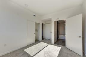 Bedroom with Carpet, Closet Door, Bathroom Entrance