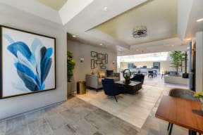 Leasing Office with Couch, Chairs, and Abstract Blue Painting on Wall