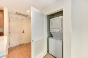 Washer and dryer Inside Closet, and Hardwood Inspired Floors