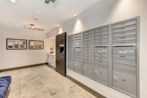 Mail delivery room with parcel lockers and mailboxes.