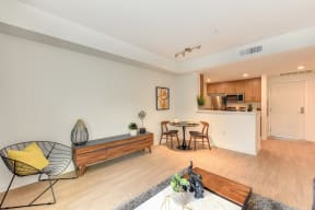 Living area with seating and hardwood inspired flooring,