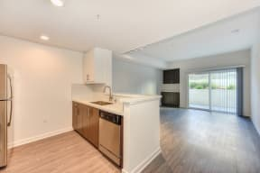 Kitchen with View of Living Room, Dishwasher, Refrigerator and Patio