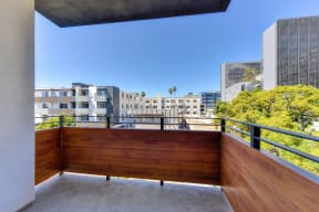Large patio area with views of LA buildings and trees