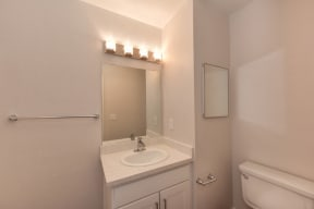 Bathroom with Vanity, White Cabinets and Towel Rod
