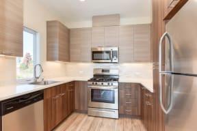 Kitchen with Hardwood Inspired Floors, Stainless Steel Fridge/Freezer. Dishwasher, Oven, Microwave