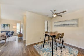 Dining Area, Ceiling Fan, Hardwood Inspired Floor, and Rug