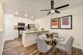 Luxury Apartment Community Dining Area with Wood Inspired Floors