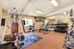 Fitness Center with Free Weights, Rug, Workout Bench, Rug and Ellipticals